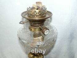 Lampe pétrole bronze, toupie cristal de Baccarat et tulipe Saint Louis