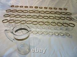 Service complet de 48 verres et carafe en cristal avec dorure. Saint louis
